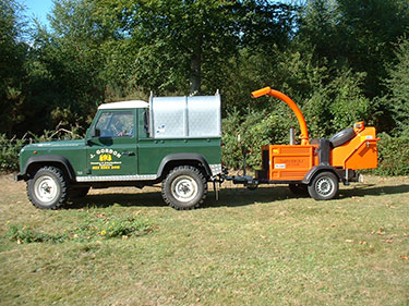 Tree surgeon landrover and chipper in Hampshire